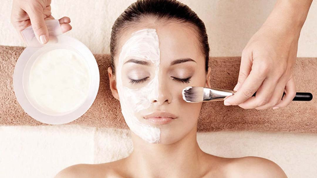 A woman receiving a chemical peel from Natural Face Aesthetics in Malmesbury, Wiltshire.